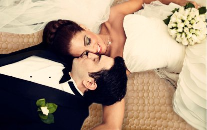 Bride and groom nuzzling their faces together and smiling