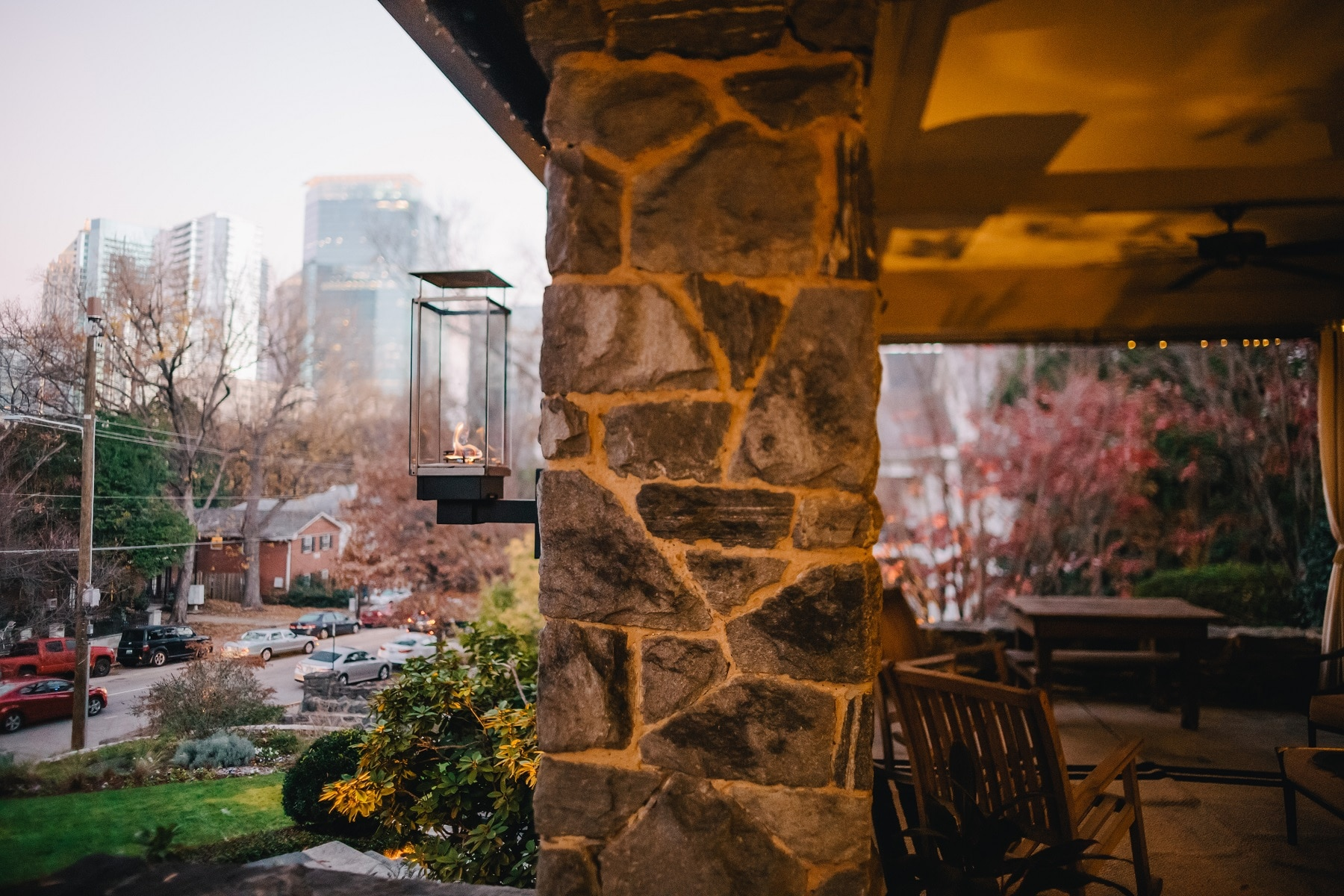 The front porch of Stonehurst Place with the city skyline in the background