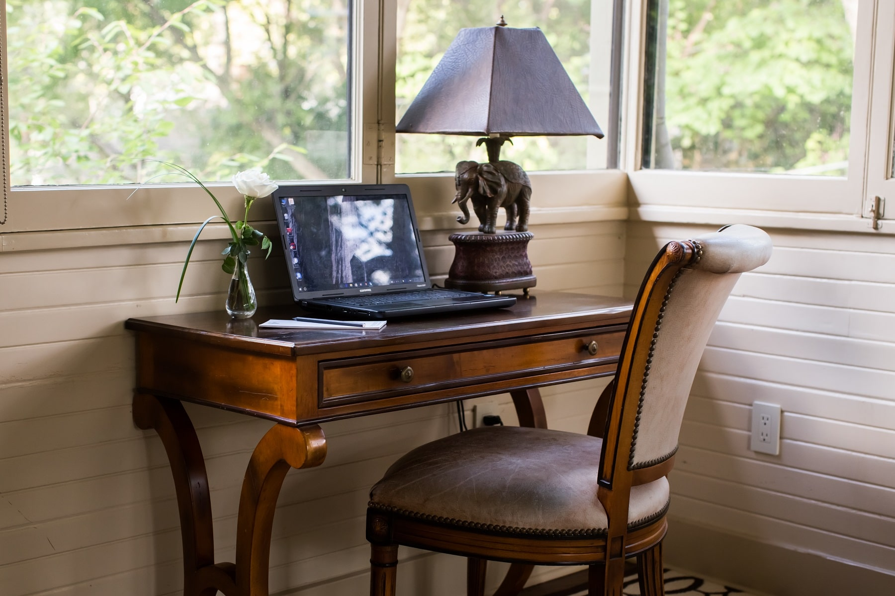 A desk with a laptop on it at Stonehurst Place