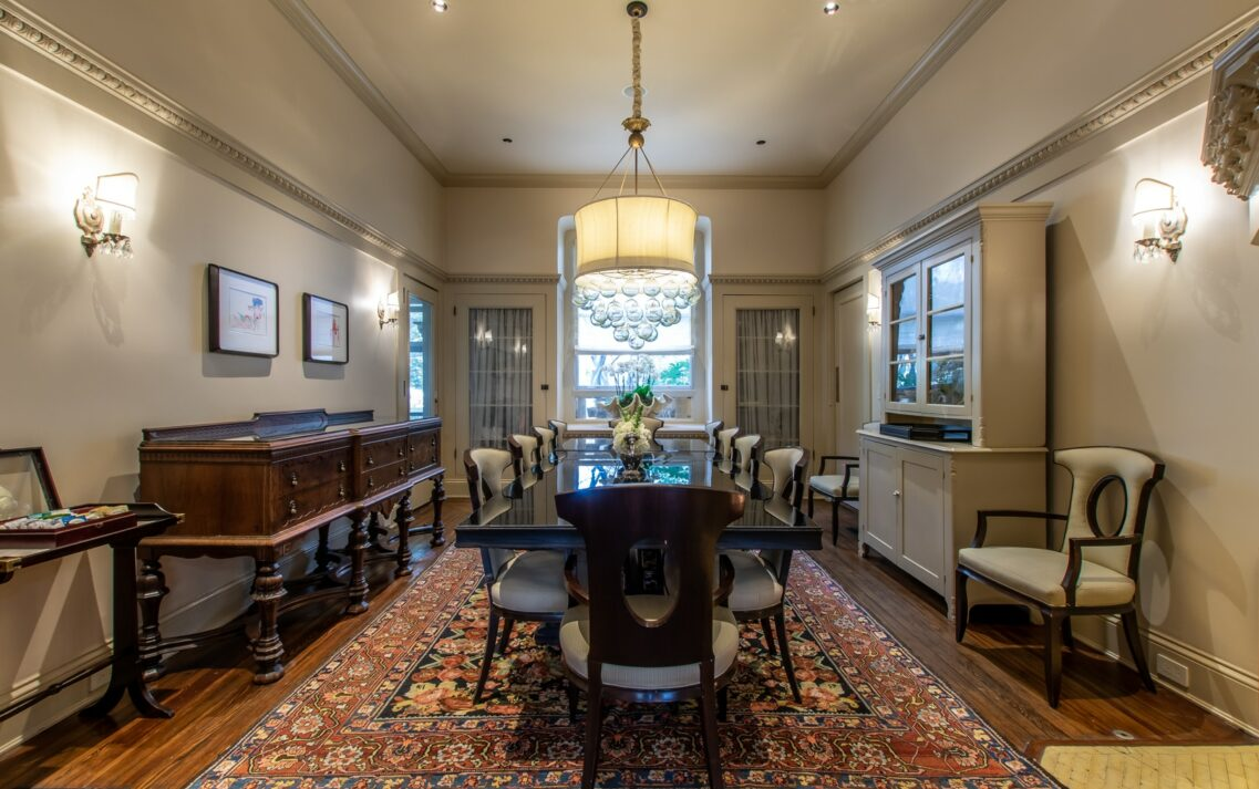 Stonehurst Place dining area with large chandelier in the center