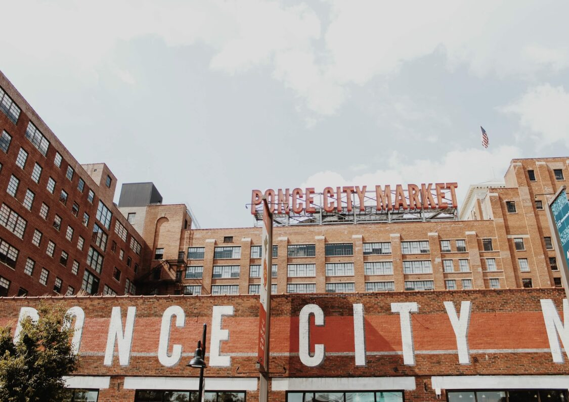 Ponce City Market Sign atop brick building