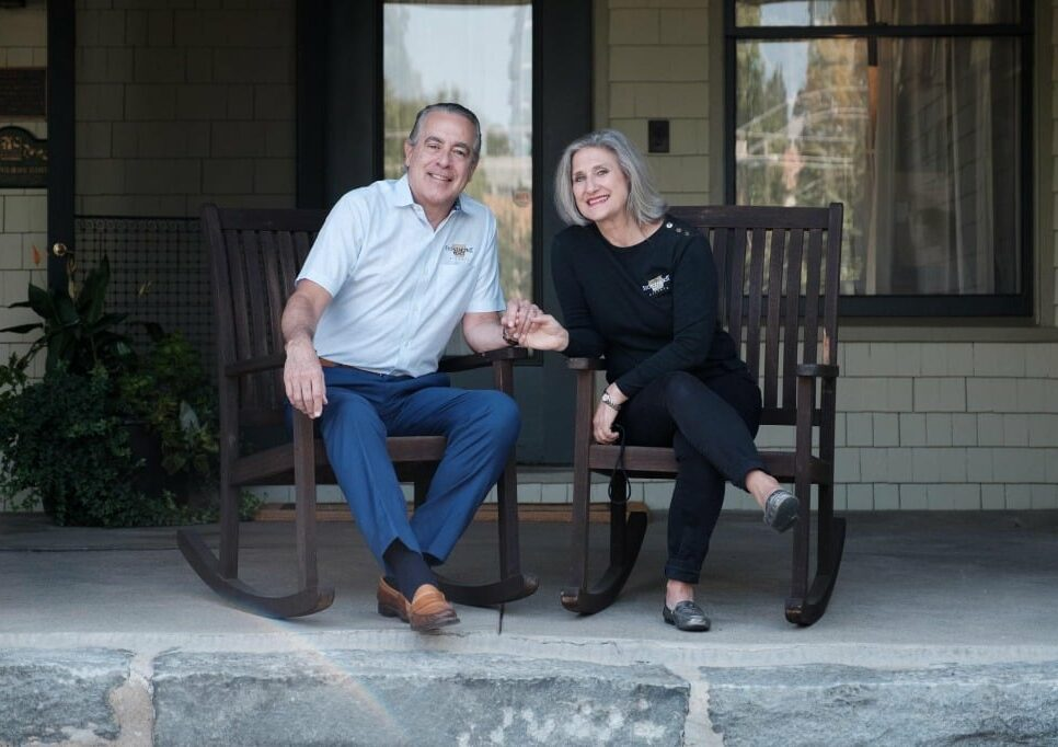 Innkeepers smiling together while holding hands