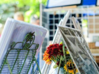 Flowers and paintings at the Piedmont Park Arts Festival