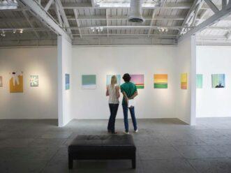 Couple exploring one of the Midtown Atlanta art galleries