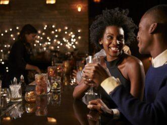 Two people at a bar enjoying the Midtown Atlanta nightlife