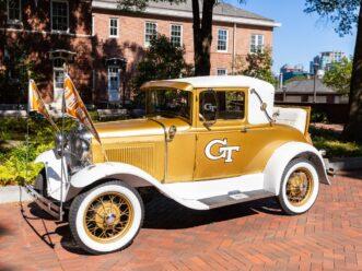 Old-fashioned gold car outside Georgia Tech