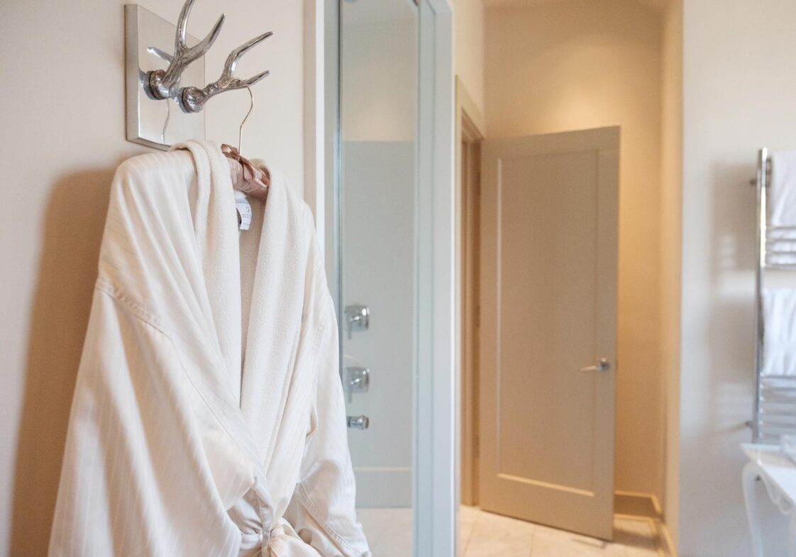 Master Suite bathroom with robe hanging on wall in Stonehurst Place