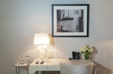 Stedman Suite desk with black and white picture of a woman on wall above in Stonehurst Place