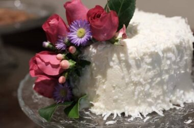 Wedding cake with flowers on top in Stonehurst Place