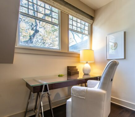 Master Suite white arm char with wood and glass desk