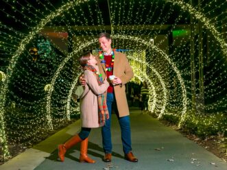 A couple at the Atlanta Botanical Garden enjoying one of the best things to do in Atlanta in December