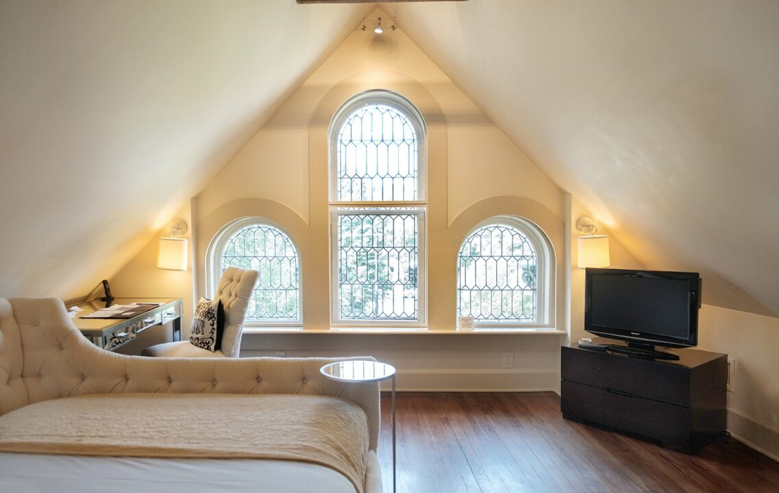 Eaves Room with large arched windows in Stonehurst Place