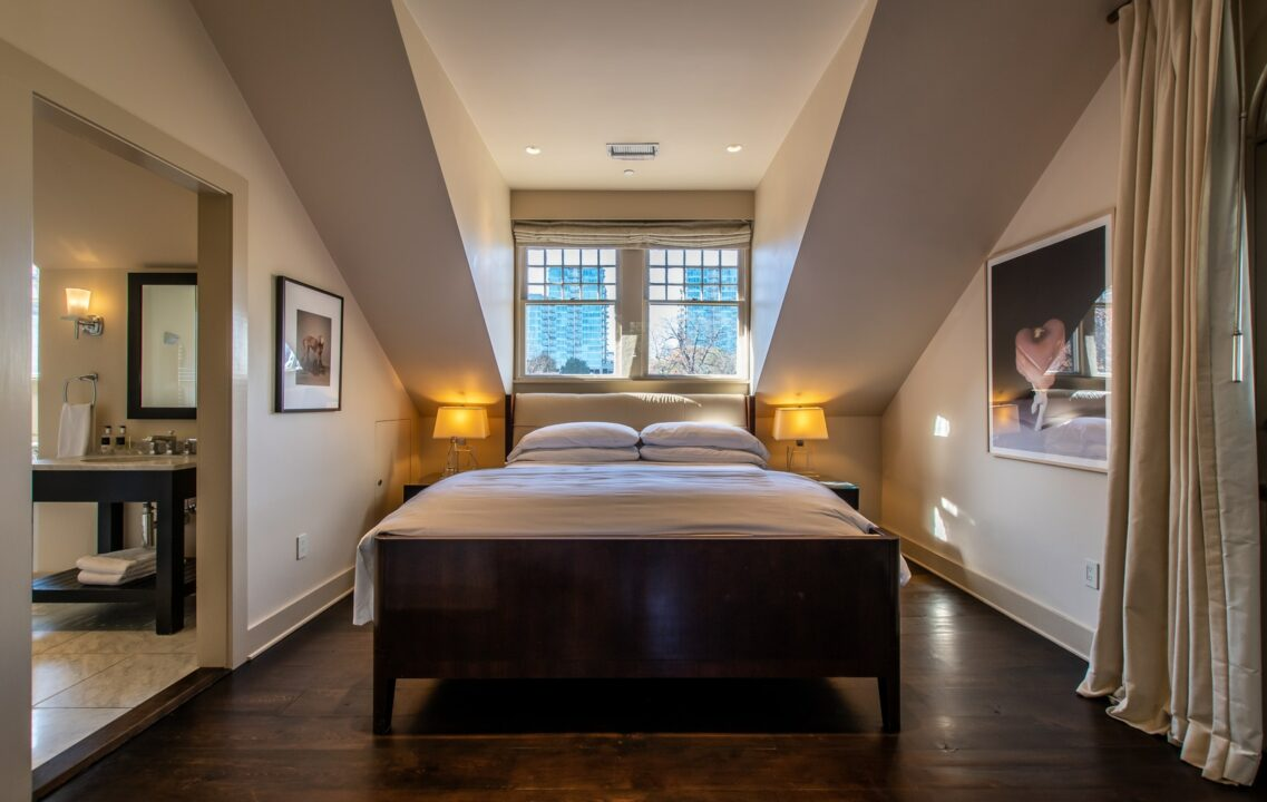 Master Suite bed with windows overlooking Atlanta